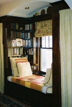 Window seat. Bookcases.