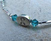 Ovarian Cancer Awareness bracelet I have. Made by Pam Hurst Designs