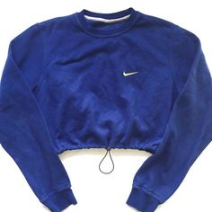 Reworked Nike Crop Sweatshirt Royal ($48) ❤ liked on Polyvore featuring tops, blue crop top, nike, nike top, cut-out crop tops and crop top