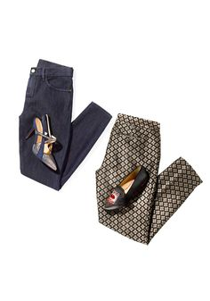 Pants can be just as elegant and dressy as skirts. The key is to pair them with the right shoes. Try patterned pants and jeweled flats. Or choose dark blue jeans (without contrasting seams, for a more formal vibe) and pair them with snazzy heels.