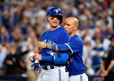 Toronto Blue Jays shortstop Troy Tulowitzki (left) is restrained by a teammate as the benches clear following the 7th inning against the Texas Rangers in game five of the ALDS at Rogers Centre. (Nick Turchiaro/USA Today Sports)