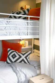 Add a little straight or corner shelf at each bunk bed level for the boys' book & reading light! Love!
