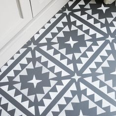This large tile inspired floor stencil is perfect for adding interest to floors. Use it on bare or painted floorboards, laminate flooring, tiles. Stenciled Concrete Floor, Painted Concrete Floors, Painting Concrete, Stained Concrete, Concrete Patio, Painting Laminate Floors, Laminate Flooring, Flooring Tiles, Painted Laminate Countertops