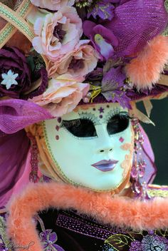 Orange and purple with a detailed and mysterious mask