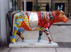 "Manchester, England -  Cows on Parade 2004 - ""Rainbow"" - 121 life size fiberglass cow statues"