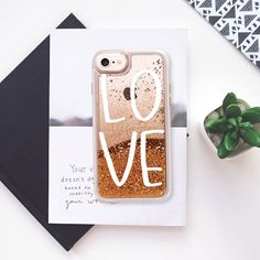 "Hand Lettered L O V E // ""Love"" iPhone phone case // Transparent hard shell liquid glitter waterfall for a dreamy, snowglobe-like effect."