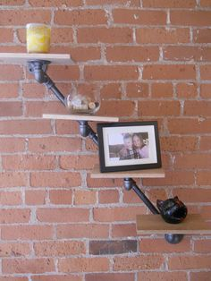 Industrial pipe string shelf. $95.00, via Etsy....I could so make this.