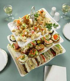 Picnic ideas:  wraps, sandwich bites, sushi rolls, fresh fruit...many oclors and shapes