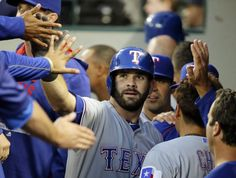 Texas Rangers' Mitch Moreland, center, is greeted in the dugout after he hit a solo home run during the second inning of a baseball game against the Seattle Mariners, Tuesday, Sept. 8, 2015, in Seattle. (AP Photo/Ted S. Warren)