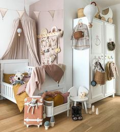 Baby Girl Nursery Room İdeas 46795283613637794 - How beautiful is this whimsical nursery and playroom by featuring our Olli Ella Luggy, See Ya Suitcase and Minichari Source by thatxonexgirl