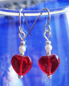Czech glass hearts in true red enhanced with genuine Swarovski ® pearls and silver-tone glass beads. The earwires aere surgical steel.  $8.00 https://www.etsy.com/shop/FrenchMermaid