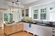 Love the windows, love the glass cabinet, and light fixtures