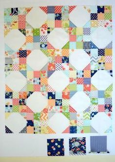 Snowball Nine Patch Pattern - Create a quilt that combines two popular types of quilt blocks effortlessly when you piece together the Snowball Nine Patch Pattern. Scrappy and absolutely lovely, you are going to adore creating this cute quilt. Using 163 charm squares (or about 2 charm packs), this adorable idea would be a fantastic way to use up the leftovers from a handful of other charm pack patterns you have created.