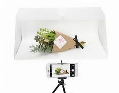 """Bigger Pop Up Photo Studio for Smartphones  Get pro photos in a snap using your iPhone or camera. Lightcase enhances the natural light. Now bigger and expandable!  SPECIFICATIONS Material: frosted Polypropylene Size: 13.3"""" H x 15.1"""" W x 11.2"""" D (337mm H x 384mm W x 285mm D) Size Collapsed: 15.3"""" x 11.4"""" Backdrop: white Yupo – 21.3″ x 14.9″ coated polypropylene Camera angles: Front shooting with infinite backdrop, top down shooting, hole size: 1.5"""" Diameter Lighting: natural or studio…"""