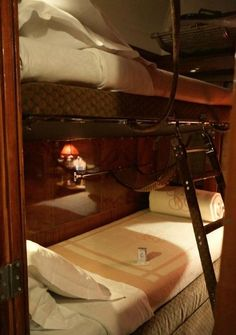 ♔ ♔ Orient Express cabin transformed by cabin steward into a bedroom after returning from dinner. I cannot see Poirot getting into the TOP bunk. I'm sure his bunk mate for the first leg of the trip had the top bunk. Orient Express Train, Simplon Orient Express, Pullman Train, Pullman Car, Train Tracks, Train Rides, Locomotive, Rail Car, Old Trains