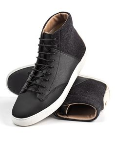 The Porter by Thorocraft $160 Any gent's wardrobe would benefit with the addition of these handmade hightop pigskin suede, textile, with a contrast raw Vachetta leather heel cap detailing which gives these urbane kicks the fashion wiggle room to dress up or down. Seriously back in black. 2014 Gift Guide: Him Photo