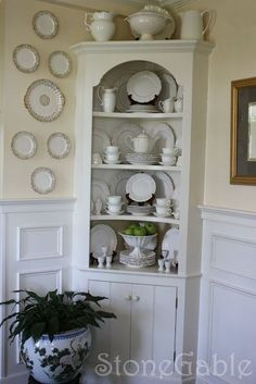 Small Space Corner Hutch With Curved Shelves And High Wainscoting   I Even  Like The Plates