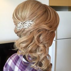 curly half updo with a bouffant long hairstyles