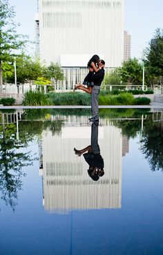 Love the reflection shot and the pose. I feel like there may be a place that look somewhat like this where we are shooting.Photographer,Fort Worth Wedding Photography, Modern Engagement Wedding Photography Inspiration Blog    View more photos from their engagement session -   http://www.monica-salazar.com/engagements/dallas-engagement-photographer-arts-district-sy