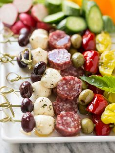 These antipasto skewers are a variety of italian meats, cheeses, olives and vegetables threaded onto sticks - an easy yet elegant appetizer. appetizers italian Antipasto Skewers - Dinner at the Zoo Holiday Party Appetizers, Elegant Appetizers, Appetizers For A Crowd, Best Appetizers, Appetizer Ideas, Party Snacks, Cold Party Food, Birthday Appetizers, Veggie Appetizers