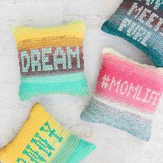 Cross stitch on crochet - pillows made from Lion Brand Mandala yarn.