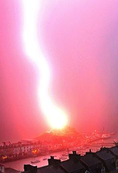 A lightning bolt hitting St Nicholas Chapel lighthouse in Devon, England. Photo by Jason Swift.