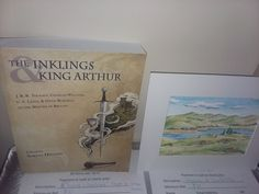 Neil Ottenstein @nottenst posted this picture of #InklingsAndArthur at the #Mythmoot silent auction next to work by cover artist Emily Austin!