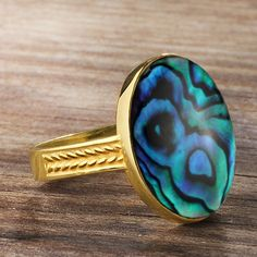 Metal: 10k Yellow Gold  Abalone:dimensions -1.3cm x 1.8cm   shape - Oval flat   setting type - Bezel setting and adhesive  Product weight: 5.0 gr  You're a man's man. You don't need anything too sparkly or frilly. Check out that flat top rich-colored abalone shell ring finished in 10k yellow gold. It's just unique enough to get you noticed without being overbearing.    ----------------------------------------------------------------------  Abalone  Abalone…