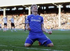 Schurrle celebrates after turning in his third goal against Fulham