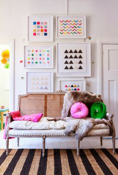 White frames and geometric patterns for art with pop of colour.