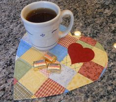 "Enjoy quick snacks on this cute little heart shaped mug rug.  A great gift paired with a mug or candle. The approximate finished size is 10"" high by 10 1/4"" wide, and it's a quick and easy project for beginners. Cut batting and 2 layers of fabric at the same time using your Go! Cutter! See other great gifts at  Accuquilt.com    ""Ideas""  Dawn Stewart of Spring Water Designs...Thanks for sharing!"