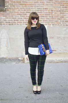 totally love -- the black sweater over a button down collared blouse, the forest green, deep navy, black,  crisp white color palette, the plaid pants