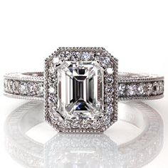 This beautiful diamond engagement ring favors clean, straight lines. The band and the halo are both done in micro pave and the shape of the halo mimics the emerald cut center stone. Design 1646 from Knox Jewelers