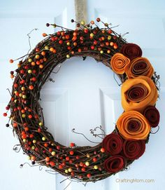 Make this colorful wreath for less than $10! Start by downloading this rosette template to cut swirl shapes out of felt. Tightly roll the ends of each flower together and secure with double-sided tape. Arrange your rosettes on a grapevine wreath and attach with a hot glue gun. Extra credit: Add sprigs of fall berries to complete the look.     Get the tutorial from Crafting Mom