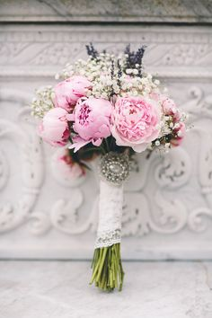 Pink peony bouquet wrapped in lace ribbon & finished with an vintage brooch - Cambridge Church Wedding with Bride In Toscana By White One - Image by Albert Palmer