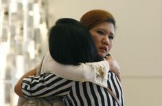 Relatives of a passenger onboard the missing Malaysia Airlines flight MH370 cry inside a hotel they are staying, in Putrajaya March 10, 2014. REUTERS/Samsul Said