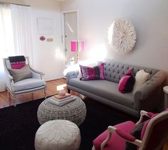 Cute and girly apartment deco<3 gray couch, grey and white ottomans, colorful, decorative pillows, pink chair, etc. Love.