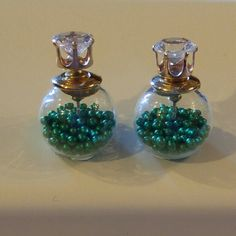 Double Sided Earrings Green Beads Double Sided Earrings  $9.00 for 1 pair  $8.00 each for 2-3 pairs  $7.00 each for 4-5 pairs  $6.00 each for 6+ pairs Jewelry Earrings