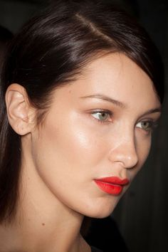 At Max Mara, make-up by Tom Pecheux focused upon bold red lips and subtly defined eyes.