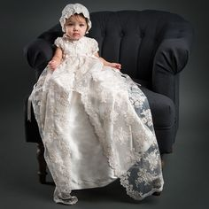 The Penelope Christening Gown  is stately and stylish with a chic 100% silk dupioni under gown and a resplendent embroidered lace over gown. Your little one will be radiant in this exquisite Heirloom gown.