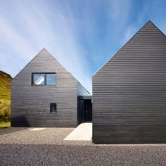 The four buildings that make up this house on Scotland's Isle of Skye were designed by Dualchas Architects to reference an old black shed found nearby.