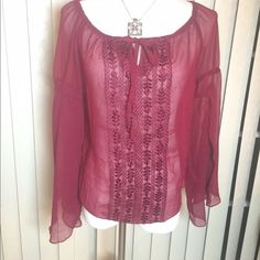 Sheer Long Sleeve Top Sheer burgundy color top with front stitching and open flutter sleeves.  Single tie at bodice.  Nwt Wet Seal Tops Blouses