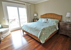 natural headboard with green comforter - Harry's Harbor photos Oceanfront home in Pine Island Reserve Corolla