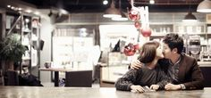 a couple is kissing each other in Korean pre wedding photo shoot