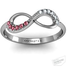 Infinity Ring with his and her birthstones and anniversary date.