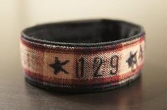"""*The Thresher Bracelet - Made with Navy working blues, """"129"""" symbolizing the 129 Sailors that perished aboard The USS Thresher. At 9:18 a.m. on April 10, 1963, sonar operators aboard the U.S. Navy submarine rescue ship Skylark, which was accompanying the nuclear attack submarine Thresher, heard a chilling sound """"like air rushing into an air tank,"""" and Thresher was no more."""