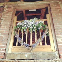 Flowers hanging from the mezzanine floor in Packington ceremony barn