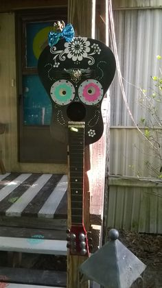 sugar skull birdhouse from guitar