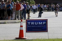 People line up outside a campaign rally for U.S. Republican presidential candidate Donald Trump in Hampton