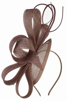 Mocha Contemporary Style Sinamay Hairband Fascinator A stunning mocha colour hairband fascinator, such an elegant design, perfect for Ascot and weddings. Facinator Hats, Sinamay Hats, Black Fascinator, Millinery Hats, Fascinators, Sombreros Fascinator, Hairband, African Hats, Funky Hats